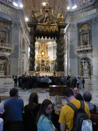 The faithful praying over St. Peter's tomb, and the tourists kept at bay