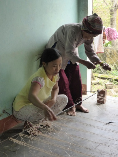 It takes 2 women 2 hours to weave a grass mat. It will sell for $2